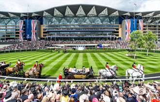 The parade ring and grandstand at Royal Ascot, Ascot Racecourse as the royal family's carriage procession arrives